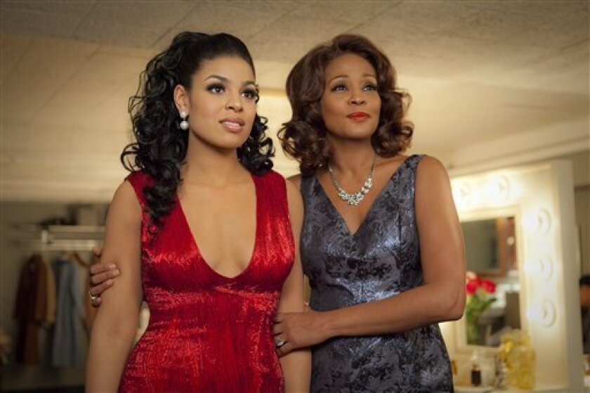 """FILE - In this undated file image provided by Sony Pictures Entertainment, singer-actresses Jordin Sparks, left, and Whitney Houston are shown in a scene from the upcoming film """"Sparkle."""" Viewers got a first glimpse of Houston's upcoming film Monday, April 2, 2012, when NBC's """"Today"""" show premiered a trailer for the much-awaited release. (AP Photo/Sony Pictures, Alicia Gbur, File)"""
