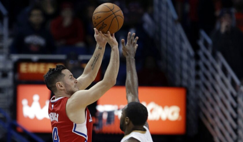 Clippers guard J.J. Redick shoots over New Orleans Pelicans guard Tyreke Evans on Jan. 30.