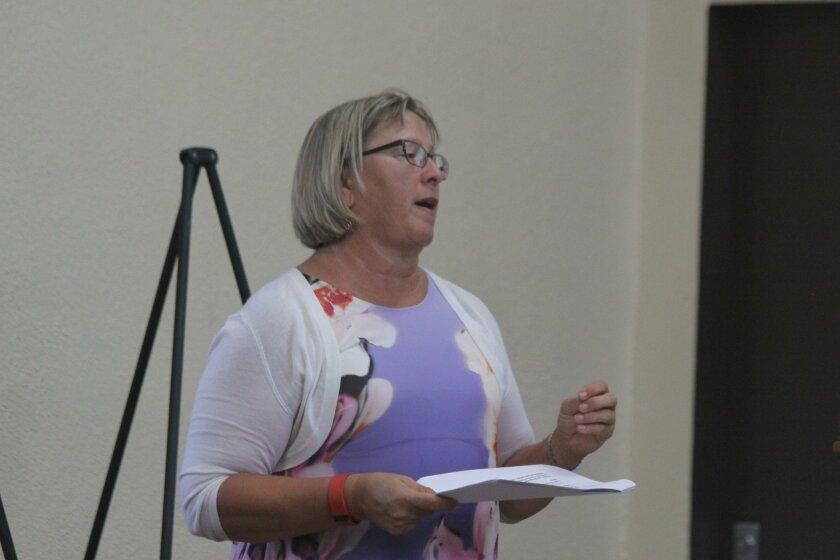 Land-use attorney Julie Hamilton speaks for neighbors opposed to the Jones Residence development.