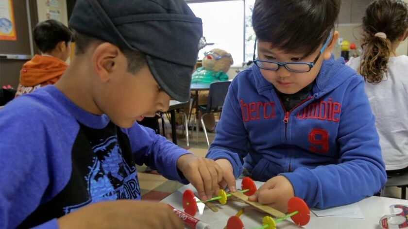 March 7, 2017 - Third graders, Brandon Pham, right, and Johnny Barker construct a miniature cart during a science class Tuesday at the school's Science/Discovery Lab.
