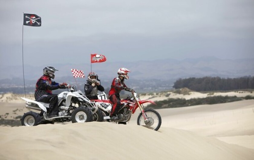 Off-roaders prepare to ride down the sand at Oceano Dunes State Vehicular Recreation Area.