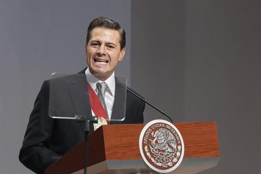 Fotografía del presidente de México, Enrique Peña Nieto, durante la presentación del sexto y último informe de su gobierno en el Palacio Nacional, sede del Ejecutivo, en Ciudad de México (México). EFE/Archivo