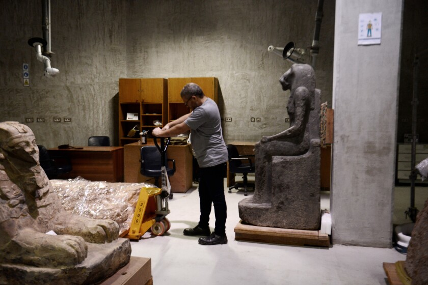 Pharaonic statues and artifacts at the Grand Egyptian Museum's conservation center. October 2018. Ph