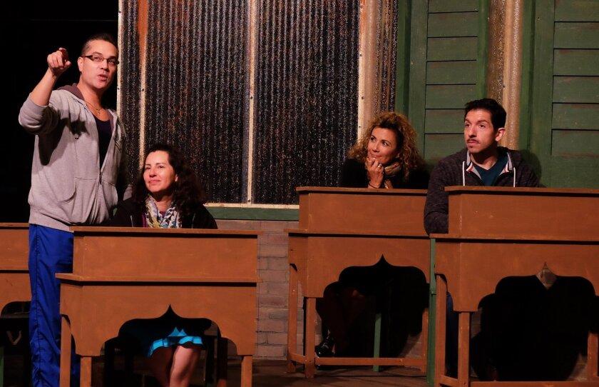 """Director Carlos Mendoza rehearses a scene from """"Anna in the Tropics"""" with Melba Novoa, Debbie Nicastro and Michael Cortez (left to right)."""