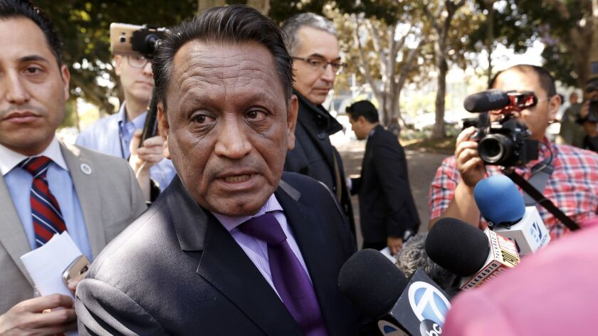L.A. City Councilman Gil Cedillo at a news conference Thursday discusses a proposal targeting businesses that have city contracts and are seeking to work on President Trump's proposed wall.