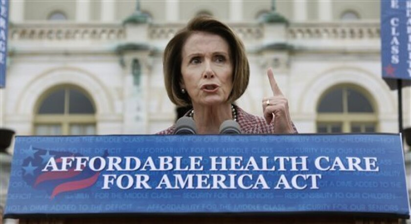 """House Speaker Nancy Pelosi of Calif. gestures while speaking about health care during a news conference on Capitol Hill in Washington, Thursday, Oct. 29, 2009. Speaking on the steps of the Capitol, Pelosi said Congress was at a """"historic moment"""" with lawmakers """"on the cusp of delivering on the promise of making affordable, quality health insurance available to every American."""" (AP Photo/Alex Brandon)"""