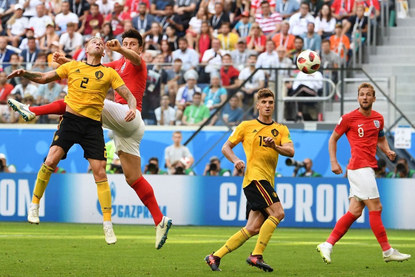 Belgium's defender Toby Alderweireld (L) and England's defender Harry Maguire (2nd L) jump for the ball during their Russia 2018 World Cup play-off for third place football match between Belgium and England at the Saint Petersburg Stadium in Saint Petersburg on July 14, 2018. / AFP PHOTO / Paul ELLIS / RESTRICTED TO EDITORIAL USE - NO MOBILE PUSH ALERTS/DOWNLOADS PAUL ELLIS/AFP/Getty Images ** OUTS - ELSENT, FPG, CM - OUTS * NM, PH, VA if sourced by CT, LA or MoD **