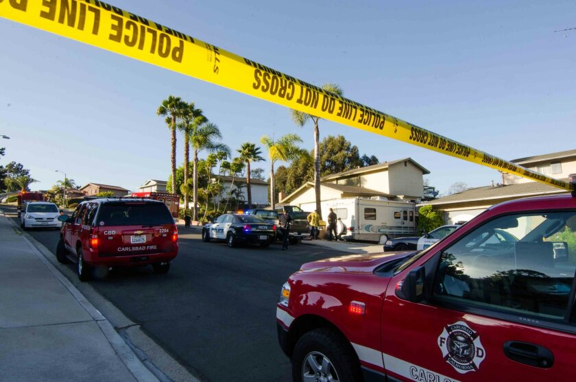 Police and firefighters at the scene of a Carlsbad homicide.