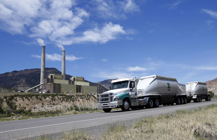 Coal trucks leave a power plant operated by PacifiCorp outside Huntington, Utah.