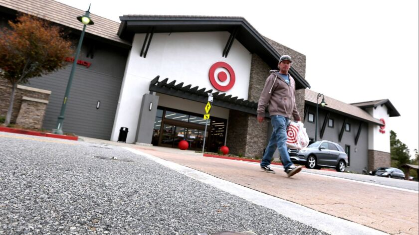 A Target shopper heads back to the parking lot using the crosswalk, which used to have safety blinki