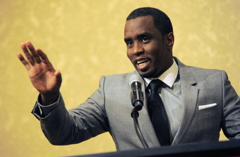 """Sean """"Diddy"""" Combs appearing in 2013 at the Beverly Hilton Hotel in Beverly Hills. On Wednesday, the Los Angeles City Attorney's office said Combs must attend a hearing to determine whether he should face charges for an alleged confrontation in June at UCLA."""