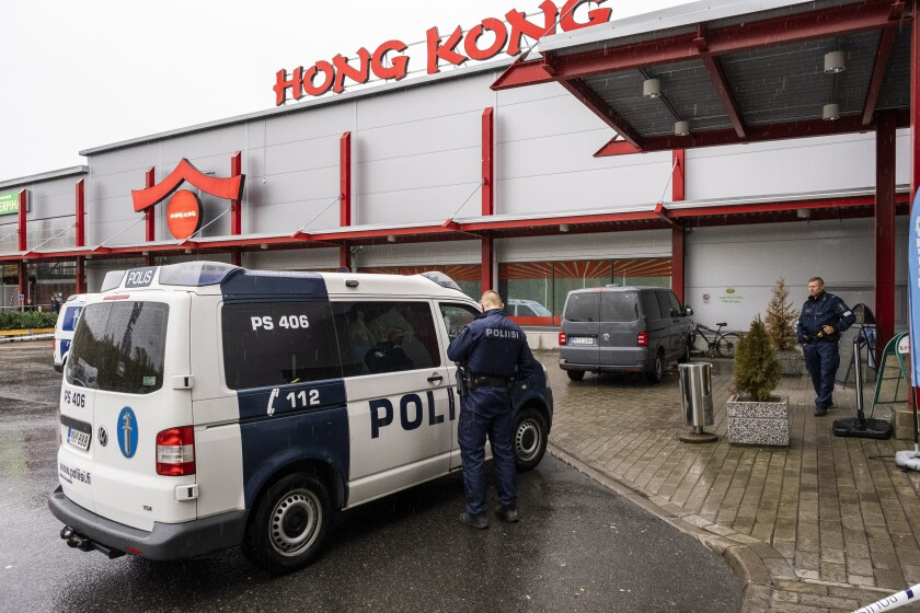 Police respond to an incident at a shopping center in Kuopio, Finland, on Tuesday.