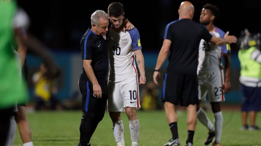 United States' Christian Pulisic, (10) is comforted after losing 2-1 against Trinidad and Tobago dur