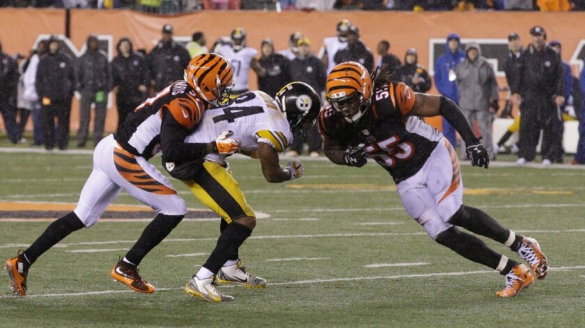 Bengals linebacker Vontaze Burfict (55) was suspended for three games for a helmet-to-helmet hit on Steelers receiver Antonio Brown during a playoff game last year.