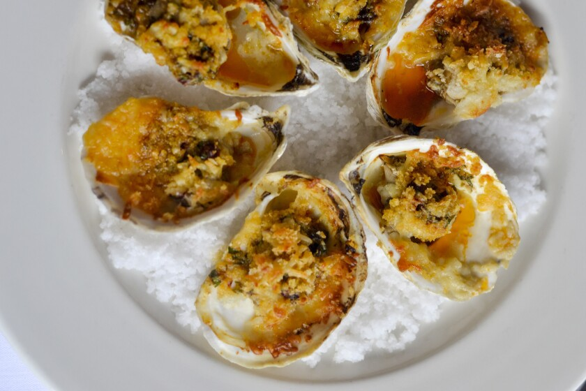 Roasted Gulf Oysters with Smoked Chilli Butter and Manchego served at Brennan's restaurant in New Orleans.