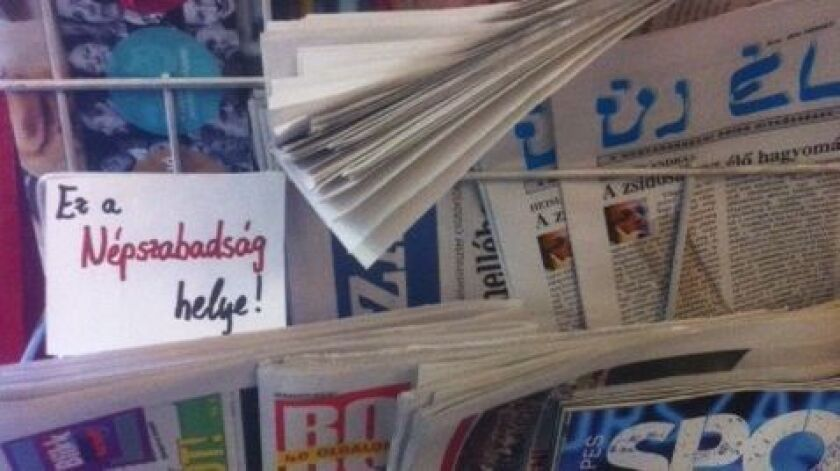 A note at a newsstand in Budapest, Hungary, shows the spot reserved for the shuttered newspaper Nepszabadsag.