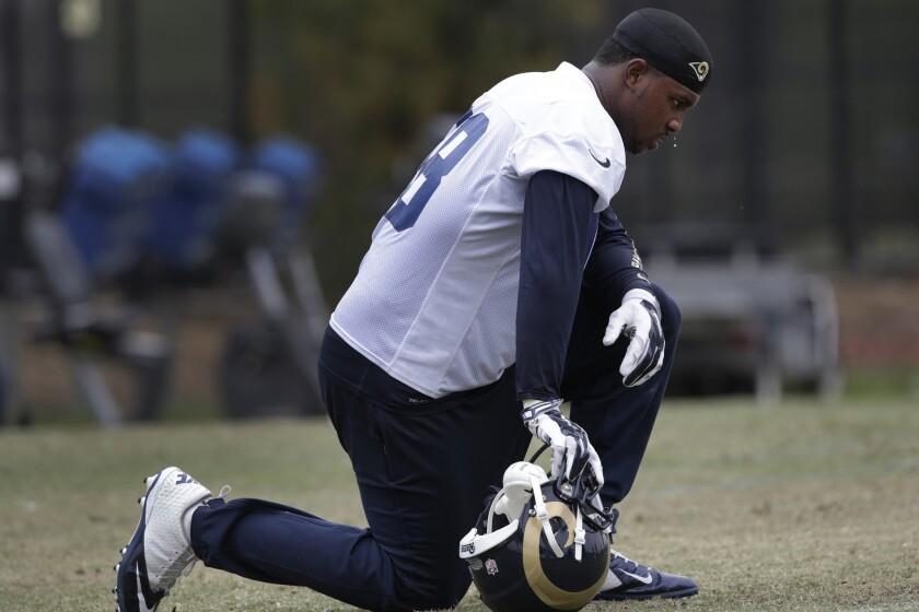 Rams defensive end Quinton Coples catches his breath during practice on June 1.