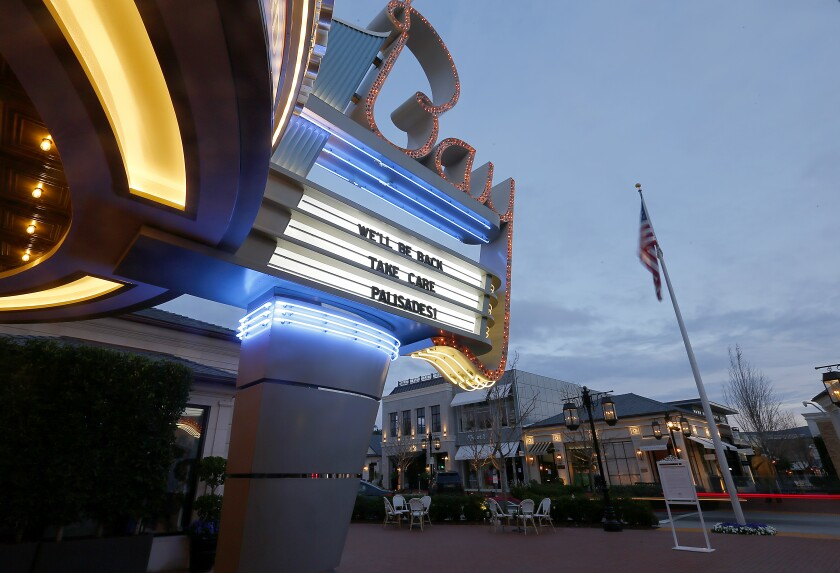 Palisades Village theater sign saying 'We'll be back'
