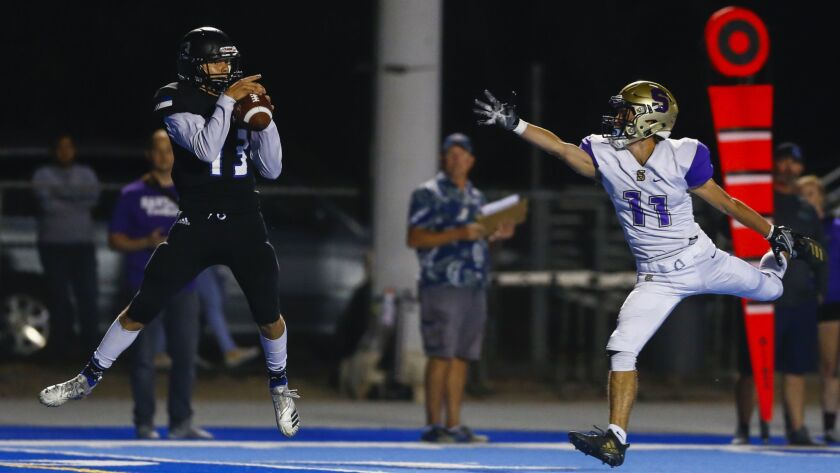 West Hills wide receiver Jack Browning (13) catches a touchdown pass on the opening drive for the Wolf Pack against Santana.