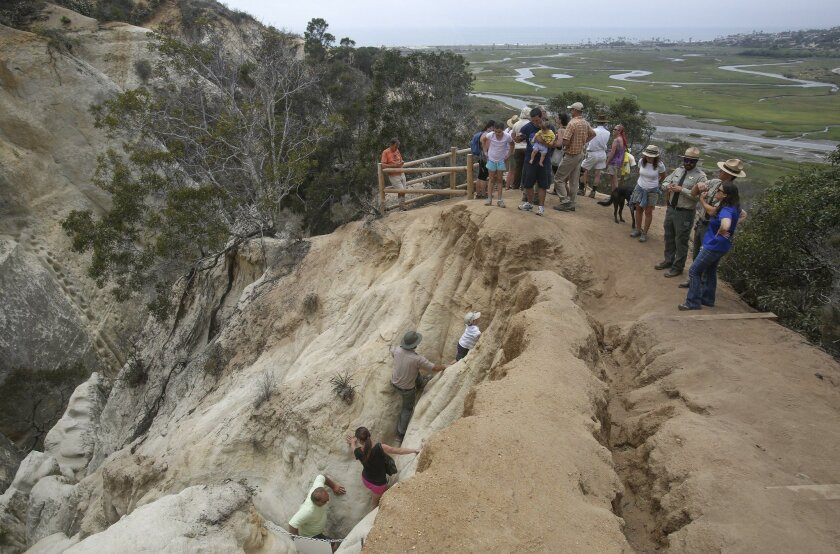 Finishing the harder route of the trail, hikers, left, reach the summit of Annie's Canyon Trail, which offers views to the ocean, Tuesday, part of the trail's opening ceremony at San Elijo Lagoon Ecological Reserve in Solana Beach and Encinitas.