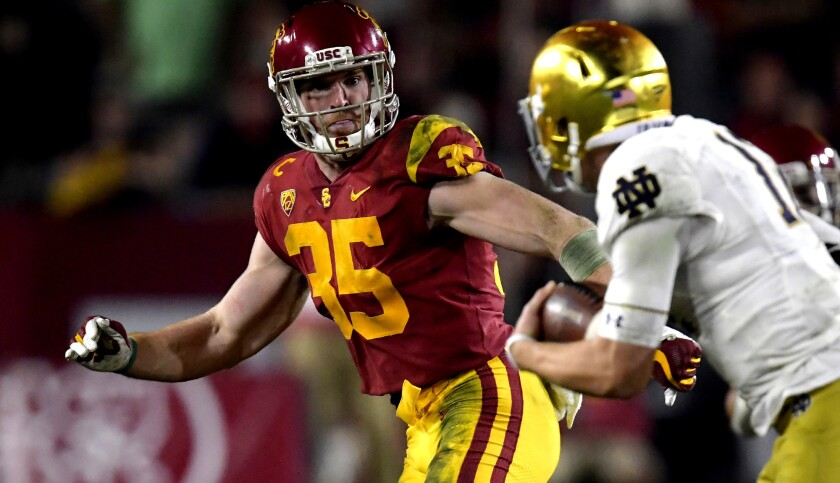 USC linebacker Cameron Smith (35) chases down Notre Dame quarterback Ian Book.