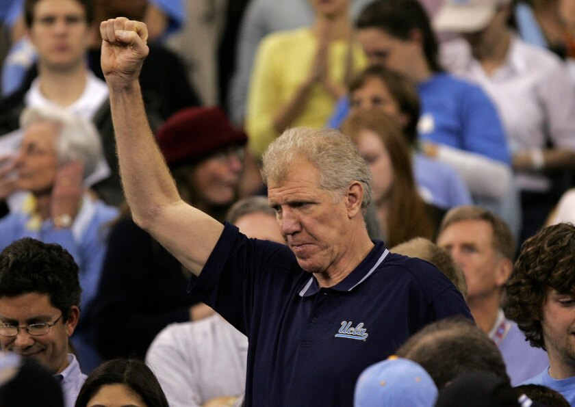 Former UCLA star basketball player Bill Walton cheers on the Bruins as they play Florida in the 2006 NCAA title game in Indianapolis.