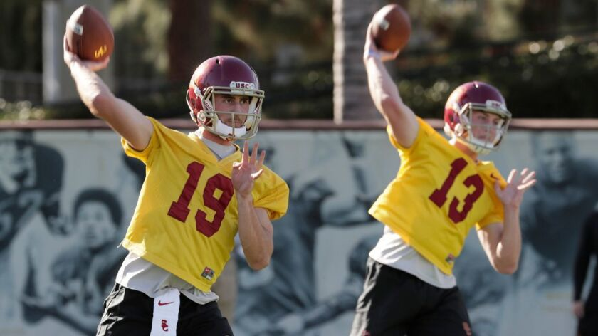 Quarterbacks Matt Fink (19) and Jack Sears (13) at spring practice.