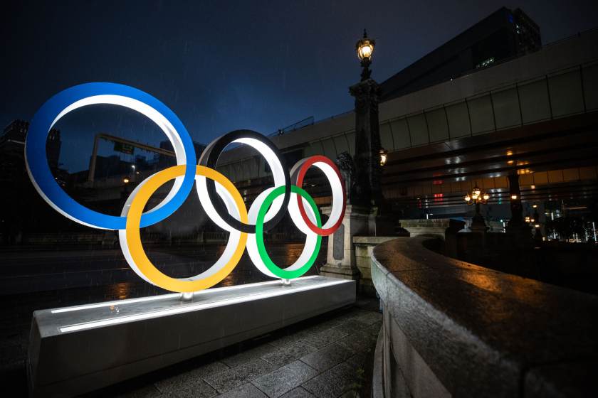 The Olympic Rings are illuminated at night