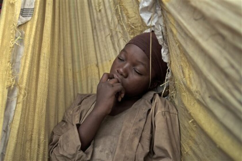 """This image released by Item 7 shows Rachel Mwanza in a scene from """"War Witch.""""  (AP Photo/Item 7)"""