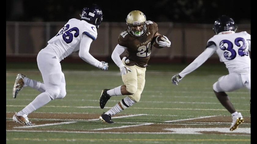 St. Francis High football player Kevin Armstead (21) is one of many athletes trying to find a college to play for. With the coronavirus outbreak, some athletes are finding the recruiting process difficult.