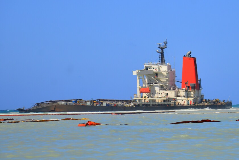 FILE — In this Sunday, Aug. 16 file photo the Japanese MV Wakashio, a bulk carrier ship that recently ran aground off the southeast coast of Mauritius, can be seen from the coast of Mauritius. The oil spill disaster turned deadly this week when a tugboat leaving the shipwreck collided with a barge and sank, killing at least three sailors, police said Tuesday Sept. 1, 2020. (AP Photo/ Sumeet Mudhoo-L'express Maurice/File)