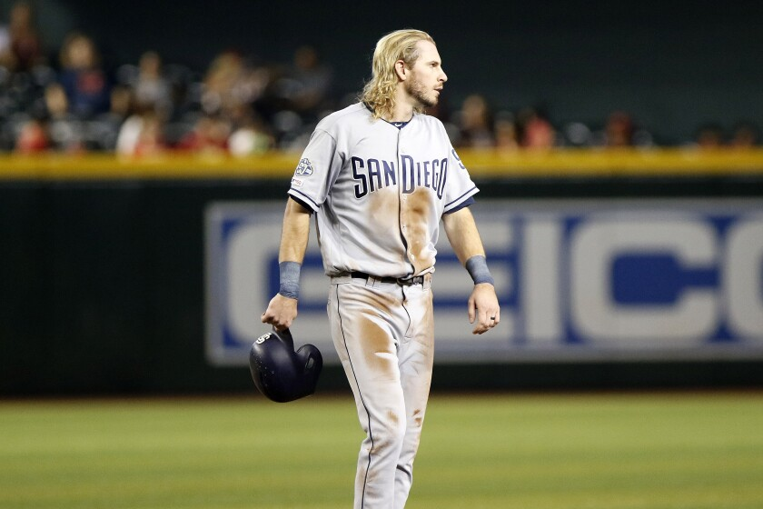 Padres center fielder Travis Jankowski walks off the field after being tagged out on a steal attempt during the eighth inning of Sunday's season finale against the Diamondbacks.