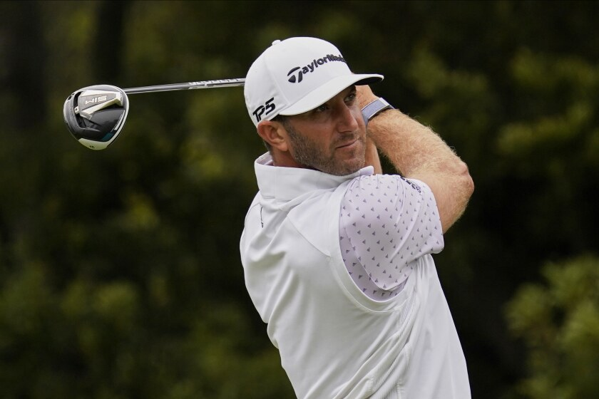 Dustin Johnson watches his tee shot on the 12th hole during the third round of the PGA Championship golf tournament at TPC Harding Park Saturday, Aug. 8, 2020, in San Francisco. (AP Photo/Jeff Chiu)