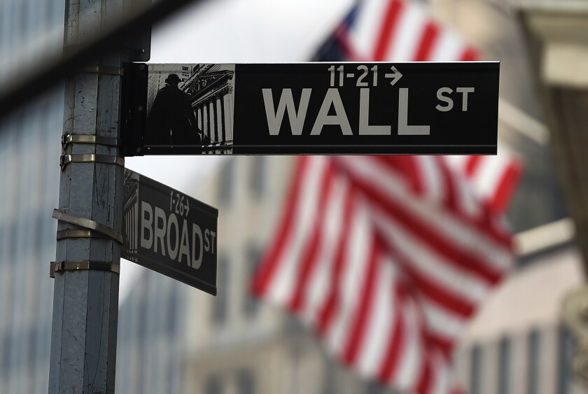 A Wall Street road sign near the New York Stock Exchange on Oct. 16, 2014.