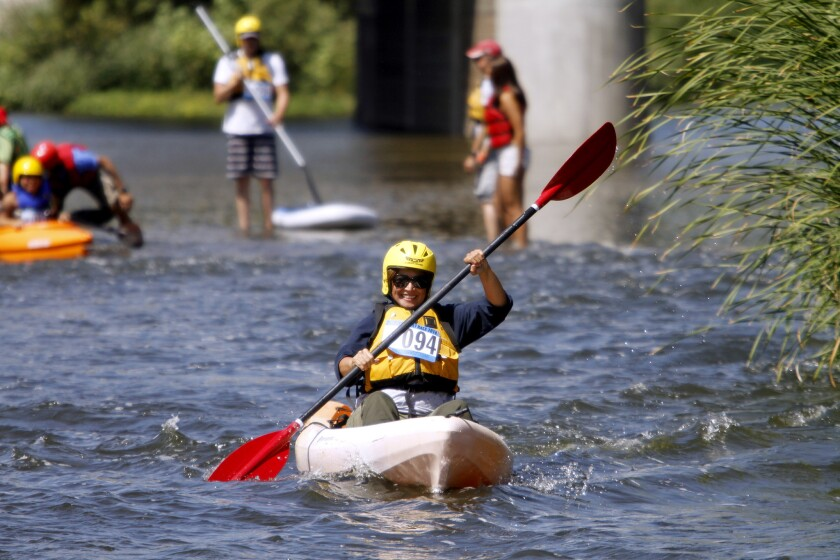 A participant heads down river in the L.A. River Expeditions first annual L.A. River boat race at Rattlesnake Park just south of Fletcher Drive in L.A. on Saturday, Aug. 30, 2014.