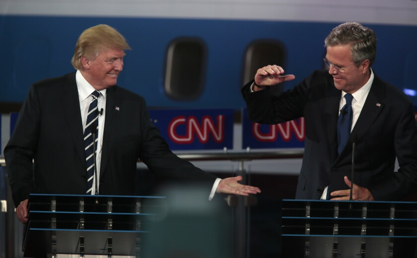 Donald Trump and Jeb Bush high-five during the Republican presidential debate at the Ronald Reagan Presidential Library in Simi Valley on Sept 16.