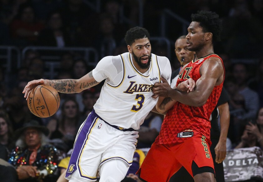Lakers forward Anthony Davis was double-teamed throughout Sunday's 122-101 victory over the Atlanta Hawks at Staples Center.