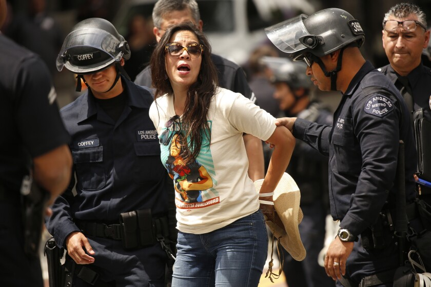 Alejandra Valles with SEIU and seven others were arrested by LAPD for failure to disperse as part of