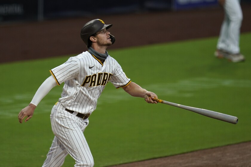 San Diego Padres' Wil Myers watches his grand slam during the first inning of the team's baseball game against the Colorado Rockies, Tuesday, Sept. 8, 2020, in San Diego. (AP Photo/Gregory Bull)