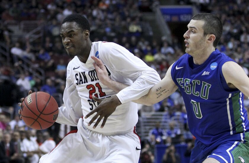 Jamaal Franklin drives to the net as FGCU Brett Comer defends in the first half.