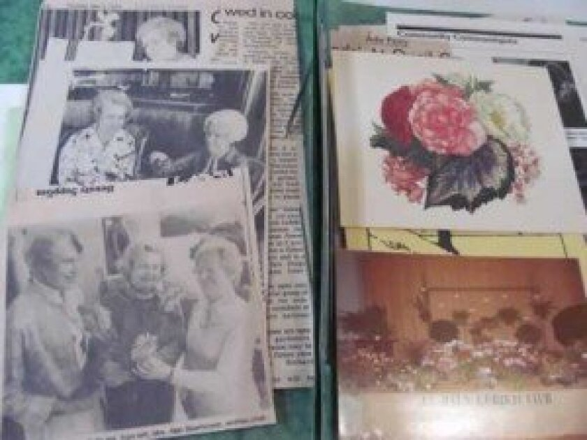 The club's yellowed scrapbook contains memories of past events.