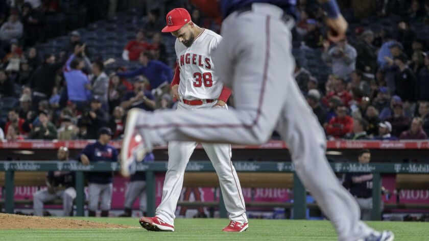 ANAHEIM, CA, TUESDAY, MAY 21, 2019 - Angels relief pitcher Justin Anderson hangs his head after allo