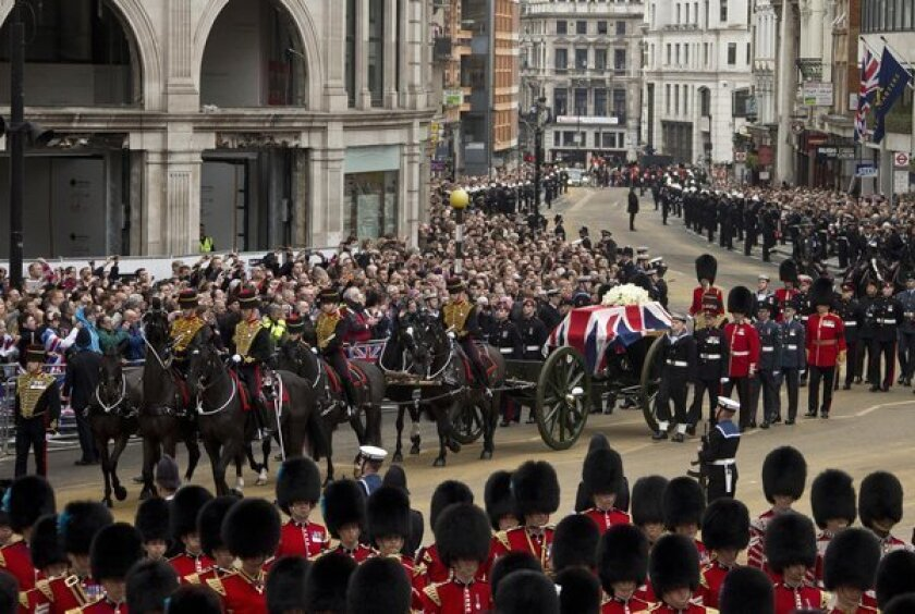 To cheers and jeers, Margaret Thatcher is laid to rest