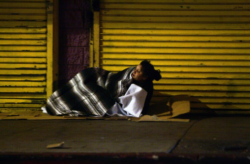 A homeless woman on the streets of skid row in downtown Los Angeles.