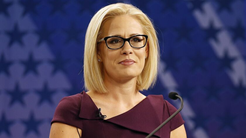 FILE - In this Oct. 15, 2018 file photo, U.S. Rep. Kyrsten Sinema, D-Ariz., goes over the rules in a