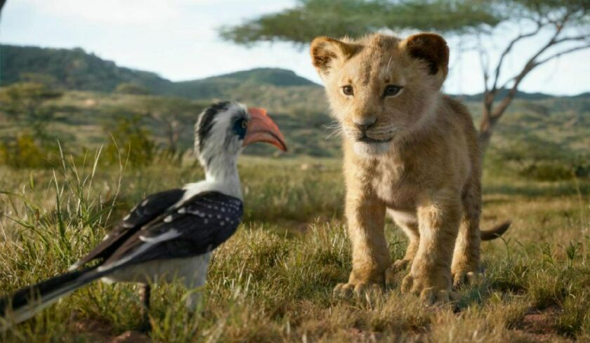 "Zazu (voiced by John Oliver) and young Simba (voiced by JD McCrary) in Disney's remake of ""The Lion King."""
