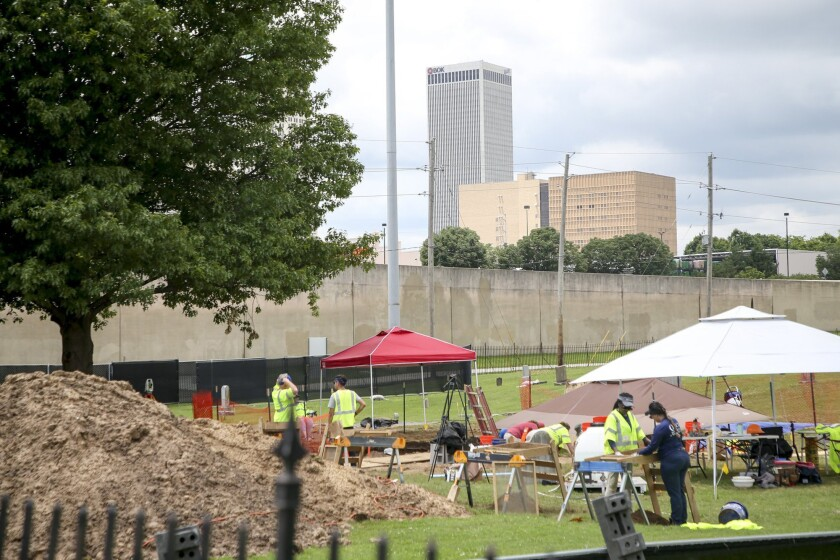 Work continues on excavating remains of possible Tulsa Race Massacre victims at Oaklawn Cemetery on Tuesday, June 8, 2021, in Tulsa, Okla. (Ian Maule/Tulsa World via AP)