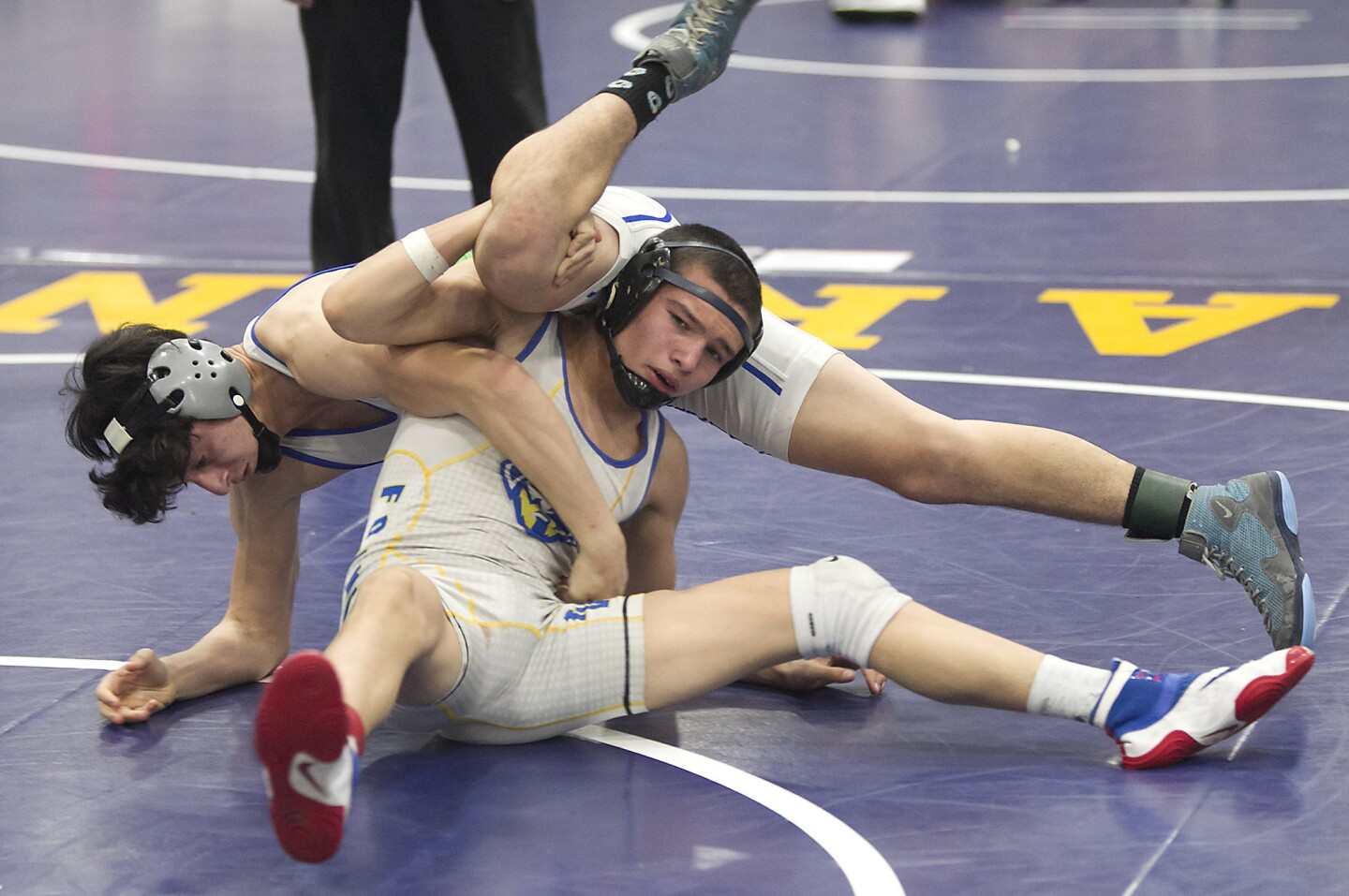 Fountain Valley's Dylan Zotea, makes a move on his opponent in the 126-lb, third place medal match, in the Five Counties Invitational wrestling tournament at Fountain Valley High on Saturday.