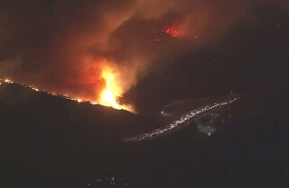 Fast-moving wildfire burns in Bel-Air