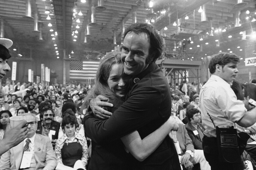 Actress Shirley MacLaine and John Burton, co-chairmen of the California delegation at the 1972 Democratic National Convention in Miami Beach, hug after pledging their support for Sen. George S. McGovern.